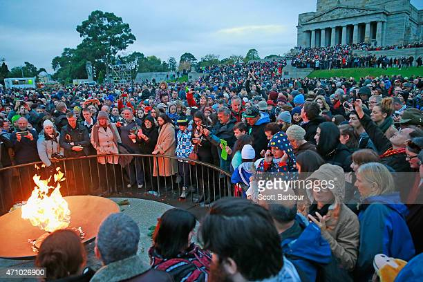 A general view as a large crowd of people gather around the eternal flame for the 2015 Dawn Service on ANZAC Day at the Shrine of Remembrance on...