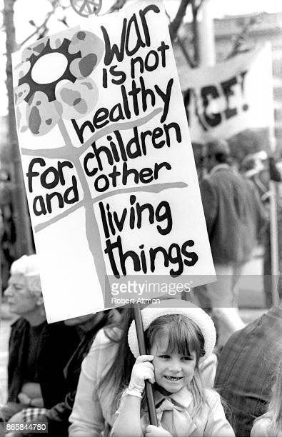 General view as a little girl holds a sign that says 'War is Not Healthy for Children and Other Living Things' during an AntiWar Rally at City Hall...
