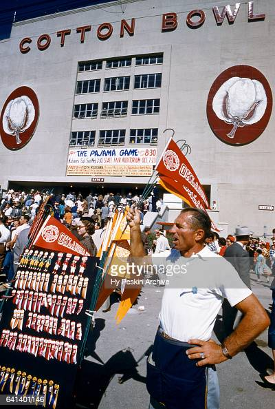 General view as a man sales pennets and other merchandise before the Red River Rivalry between the ranked Oklahoma Sooners and Texas Longhorns on...