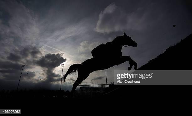 A general view as a runner clears a fence at Kempton Park racecourse on October 18 2015 in Sunbury England