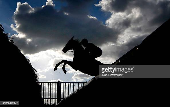 A general view as a runner clears an open ditch at Huntingdon racecourse on October 13 2015 in Huntingdon England
