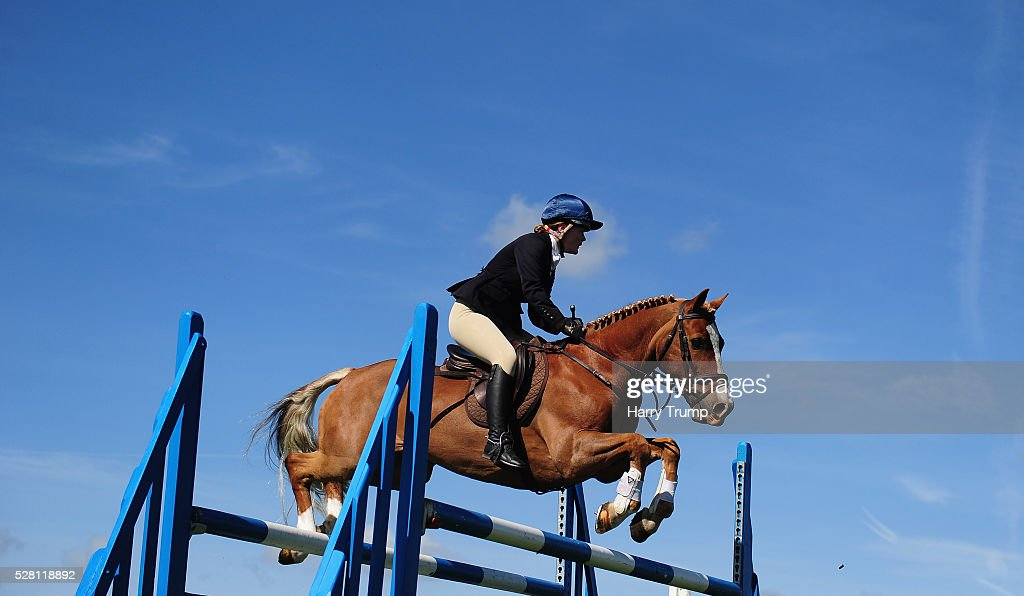 General view as a runner takes a flight during the Mitsubishi Motors Cup Show Jumping during Day One of the Badminton Horse Trials on May 4, 2016 in Badminton, Untied Kindom.