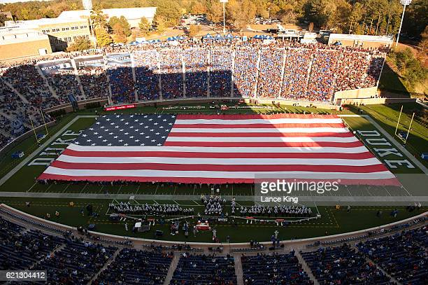 A general view as a United States flag is spread across the field during the game between the Virginia Tech Hokies and the Duke Blue Devils at...