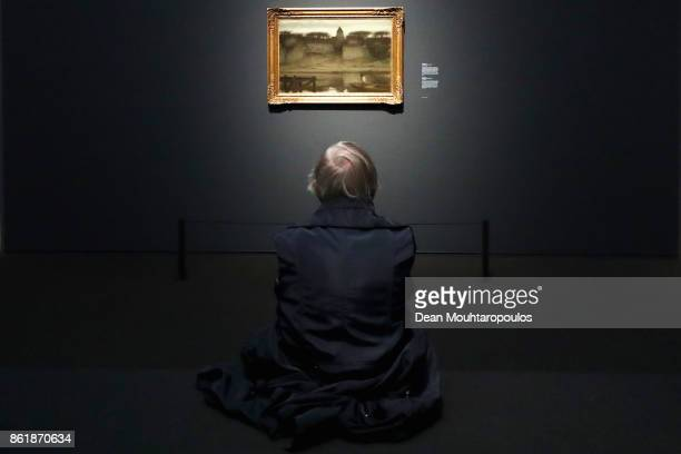 A general view as a visitor look at Saint Ouen by Matthijs Maris during a special exhibition held at the Rijksmuseum Exhibition on October 13 2017 in...
