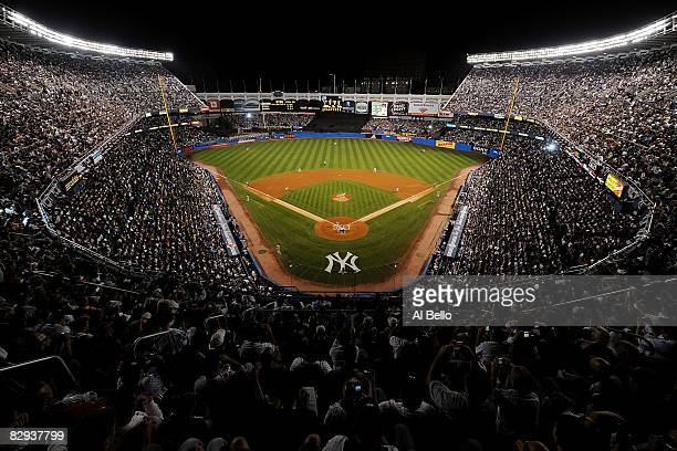 General view as Andy Pettitte of the New York Yankees throws the first pitch of the game to Brian Roberts of the Baltimore Orioles during the last...