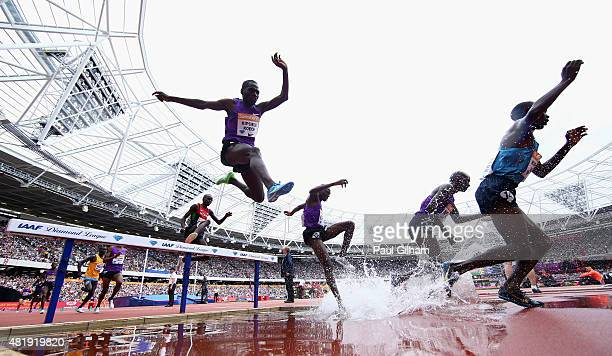A general view as athletes compete over the water jump in the Mens 3000m Steeplchase during day two of the Sainsbury's Anniversary Games at The...