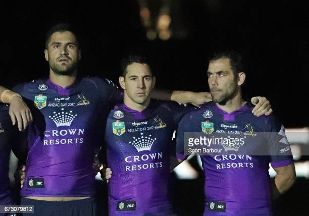 A general view as Billy Slater of the Melbourne Storm and Cameron Smith of the Melbourne Storm stand for the playing of The Last Post during the...
