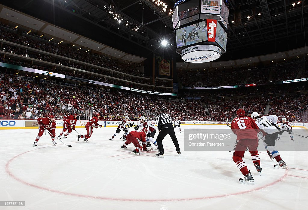 General view as <a gi-track='captionPersonalityLinkClicked' href=/galleries/search?phrase=Boyd+Gordon&family=editorial&specificpeople=209395 ng-click='$event.stopPropagation()'>Boyd Gordon</a> #15 of the Phoenix Coyotes faces off against <a gi-track='captionPersonalityLinkClicked' href=/galleries/search?phrase=Paul+Stastny&family=editorial&specificpeople=2494330 ng-click='$event.stopPropagation()'>Paul Stastny</a> #26 of the Colorado Avalanche during the NHL game at Jobing.com Arena on April 26, 2013 in Glendale, Arizona. The Avalanche defeated the Coyotes 5-4 in an overtime shoot-out.
