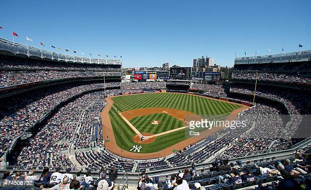 General view as CC Sabathia of the New York Yankees delivers a pitch to Adam Rosales of the Texas Rangers in the second inning on May 23 2015 at...