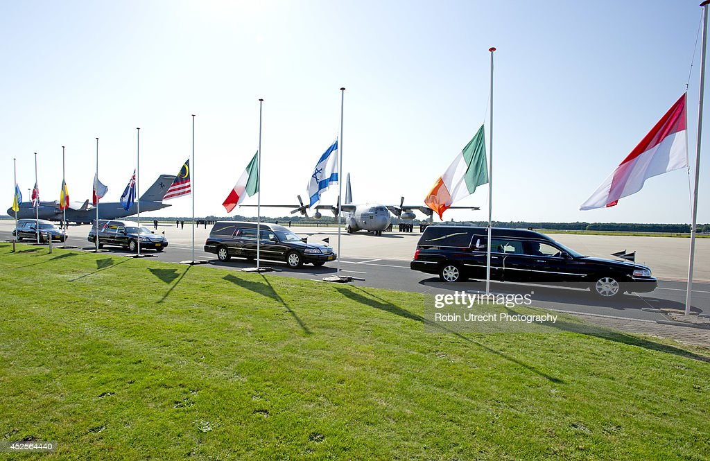 A general view as coffins are carried during a ceremony upon the arrivals of a plane from Ukraine, carrying the remains of victims of downed Malaysia Airlines flight MH17, at Eindhoven Airbase on July 23, 2014 in Eindhoven, Netherlands. Today the people of the Netherlands are holding a national day of mourning. Malaysian Airlines flight MH17 was travelling from Amsterdam to Kuala Lumpur when it crashed in eastern Ukraine killing all 298 passengers. The aircraft was allegedly shot down by a missile and investigations continue to find the perpetrators of the attack.