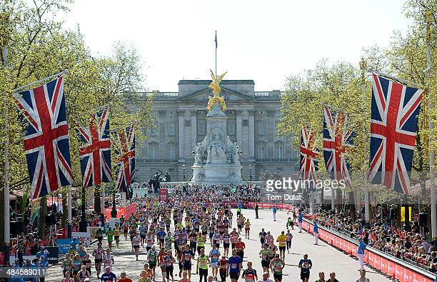 A general view as competitors make their way down the mall during the Virgin Money London Marathon on April 13 2014 in London England