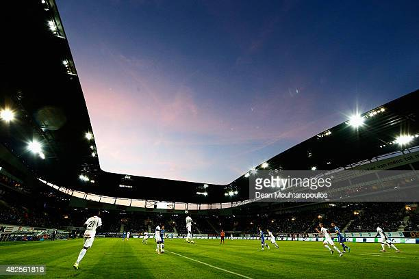 A general view as Derrick Tshimanga of Genk heads the ball out of defence during the Jupiler League match between KAA Gent and KRC Genk held at the...