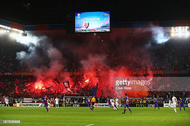 General view as fans let off flares during the UEFA Europa League Semi Final First Leg match between FC Basel 1893 and Chelsea at St Jakob Stadium on...