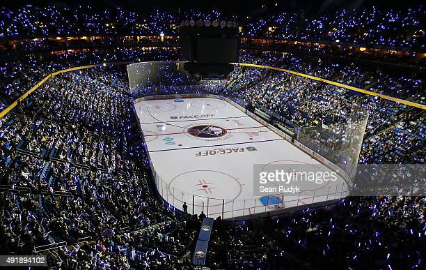 General view as fans of the Buffalo Sabres hold glow sticks during pregame ceremonies prior to the game against the Ottawa Senators on October 8 2015...