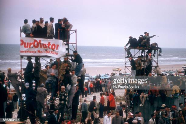 General view as fans park on the sand and stand on their cars to watch the action during the Daytona Beach and Road Course on February 26 1956 in...