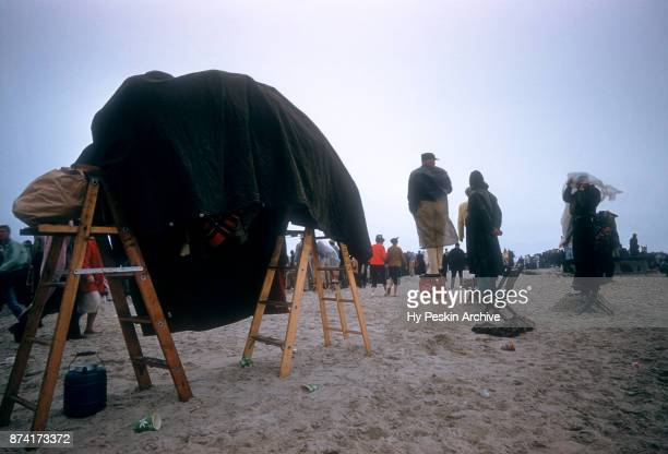 General view as fans stand on the sand during the Daytona Beach and Road Course on February 26 1956 in Daytona Beach Florida