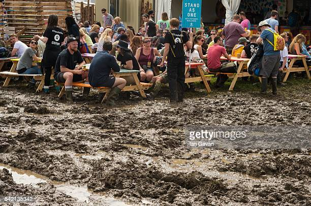 General view as festival goers arrive in the muddy conditions at the Glastonbury Festival at Worthy Farm Pilton on June 22 2016 in Glastonbury...