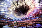 General view as fireworks illuminate the sky during the Opening Ceremony of the London 2012 Olympic Games at the Olympic Stadium on July 27 2012 in...
