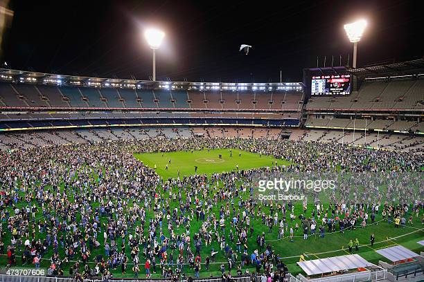 A general view as football fans play kicktokick on the ground after the final siren during the round seven AFL match between the Richmond Tigers and...