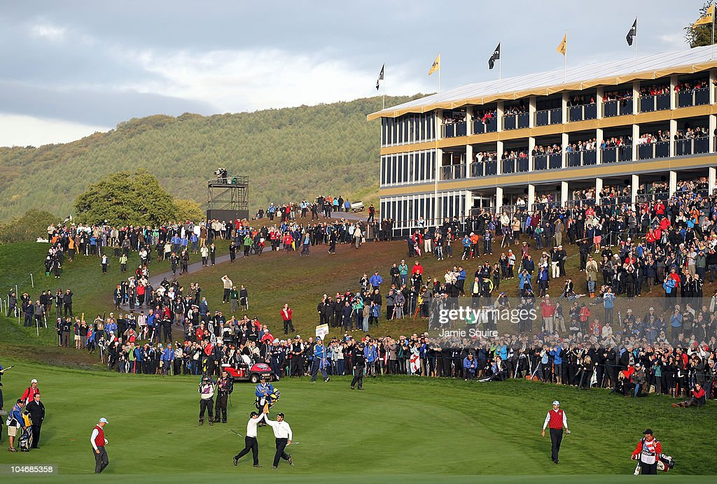 General View as <a gi-track='captionPersonalityLinkClicked' href=/galleries/search?phrase=Francesco+Molinari&family=editorial&specificpeople=637481 ng-click='$event.stopPropagation()'>Francesco Molinari</a> of Europe celebrates holing a putt for a half in his match on the 18th green with <a gi-track='captionPersonalityLinkClicked' href=/galleries/search?phrase=Edoardo+Molinari&family=editorial&specificpeople=556368 ng-click='$event.stopPropagation()'>Edoardo Molinari</a> during the Fourball & Foursome Matches during the 2010 Ryder Cup at the Celtic Manor Resort on October 3, 2010 in Newport, Wales.
