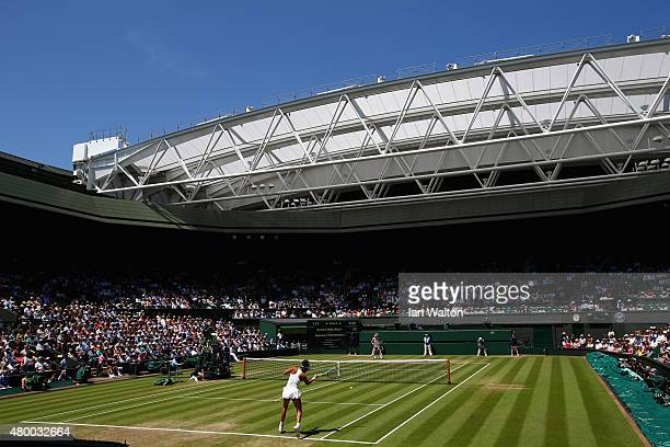 A general view as Garbine Muguruza of Spain plays a forehand in the Ladies Singles Semi Final match against Agnieszka Radwanska of Poland during day...
