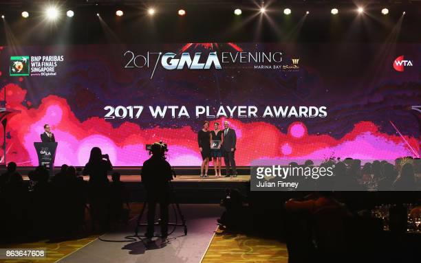 A general view as Garbine Muguruza of Spain poses with the 2017 WTA Player of the Year award with WTA Finals Legend Ambassador Lindsay Davenport of...