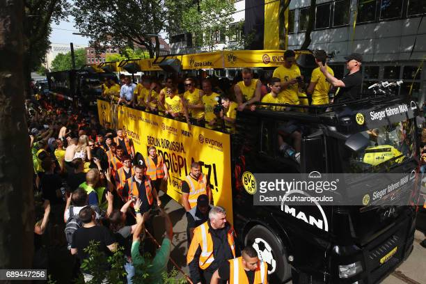 A general view as Head coach Thomas Tuchel celebrates on the team bus during a parade near Borsigplatz for the celebrations of Borussia Dortmund's...