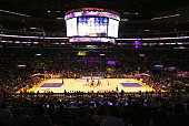 General view as Jordan Hill of the Los Angeles Lakers and Miles Plumlee of the Phoenix Suns take the opening tip off in the first period of the NBA...