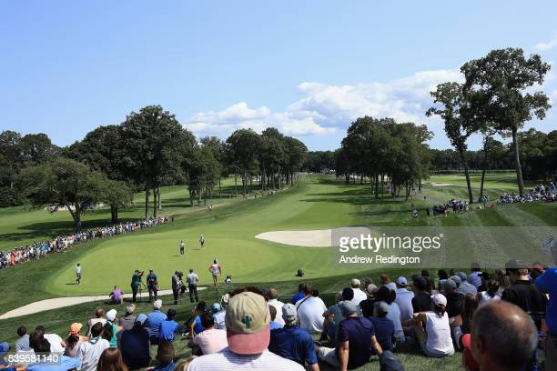 A general view as Jordan Spieth and Rickie Fowler of the United States stand on the fourth green during round three of The Northern Trust at Glen...