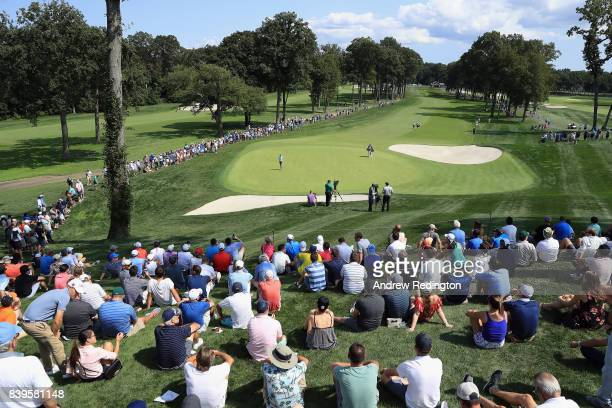 A general view as Jordan Spieth and Rickie Fowler of the United States walk onto the fourth green during round three of The Northern Trust at Glen...