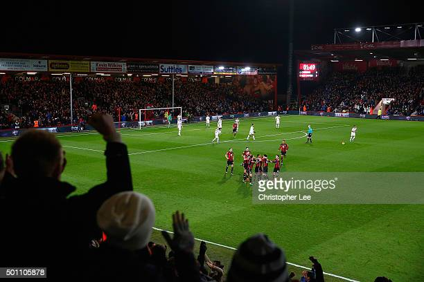 A general view as Junior Stanislas of Bournemouth celebrates scoring their first goal with his team mates as the Manchester Utd team look dejected...