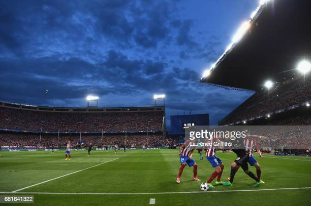 A general view as Karim Benzema of Real Madrid takes on Stefan Savic of Atletico Madrid during the UEFA Champions League Semi Final second leg match...