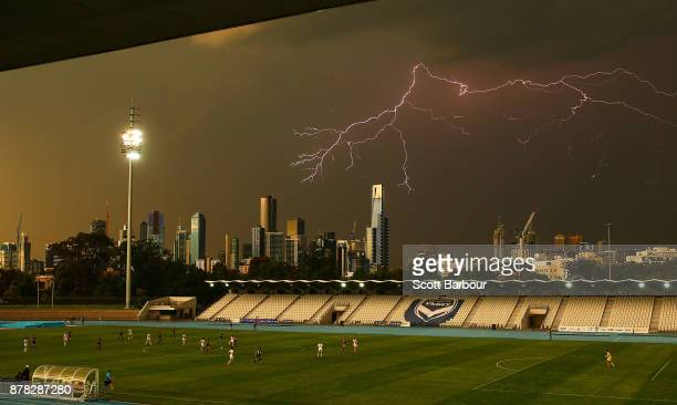 A general view as lightning strikes near buildings in the city of Melbourne during the round eight WLeague match between the Melbourne Victory and...