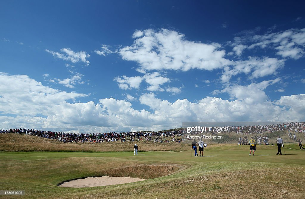 A general view as Louis Oosthuizen of South Africa putts on the 3rd green during the first round of the 142nd Open Championship at Muirfield on July 18, 2013 in Gullane, Scotland.