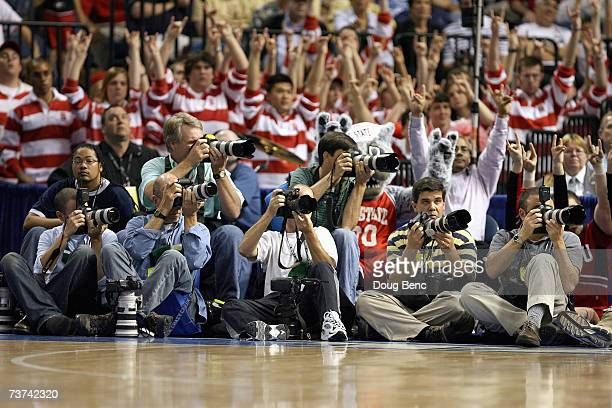A general view as media photographers capture the action courtside between the North Carolina State Wolfpack and the Virginia Tech Hokies in the...