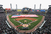 General view as members of the Chicago White Sox and the Minnesota Twins stand for the National Anthem before the White Sox home opener at US...