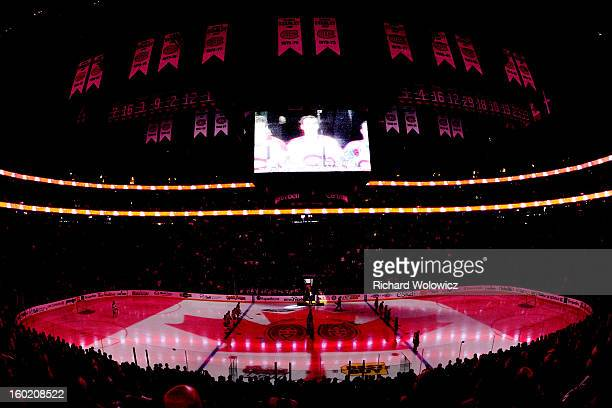 General view as members of the New Jersey Devils and Montreal Canadiens during the singing of the Canadian National anthem during the NHL game at the...