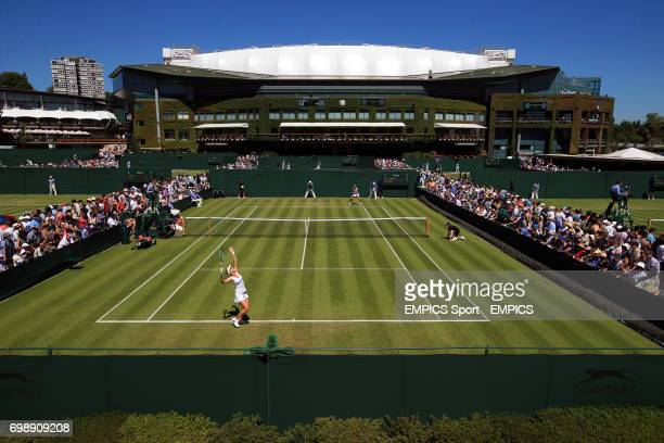 General view as Mirjana LucicBaroni serves against Yaroslava Shvedova on court ten during day two of the Wimbledon Championships at the All England...