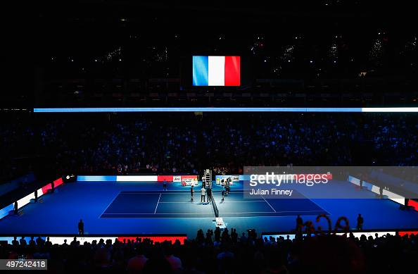 A general view as Novak Djokovic of Serbia and Kei Nishikori of Japan observe a minute's silence to remember those who lost their lives in the recent...