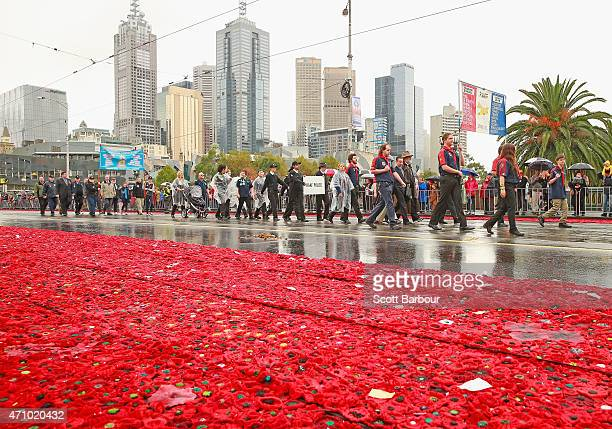 A general view as people take part in the Anzac Day March past the 5000 Poppies Project on ANZAC Day on April 25 2015 in Melbourne Australia...