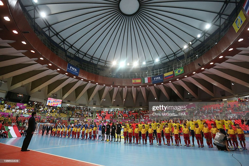 A general view as players lineup for the national anthems during the FIFA Futsal World Cup 3rd/4th Playoff match between Italy and Colombia at Indoor Stadium Huamark on November 18, 2012 in Bangkok, Thailand.