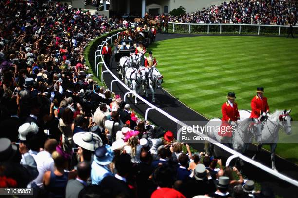 A general view as Queen Elizabeth II arrives for day four of Royal Ascot at Ascot Racecourse on June 20 2013 in Ascot England