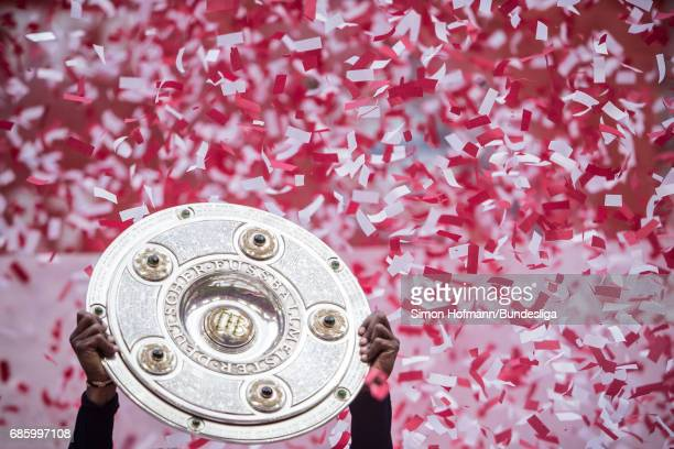 A general view as Renato Sanches of Muenchen celebrates with the trophy after the Bundesliga match between Bayern Muenchen and SC Freiburg at Allianz...
