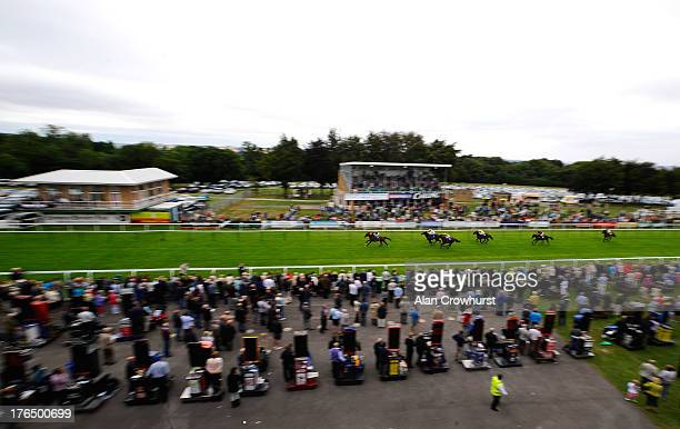 General view as Richard Hughes riding Truth Or Dare win The Stevens Garnier Ltd Nursery Handicap Stakes at Salisbury racecourse on August 14 2013 in...