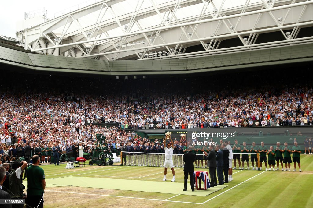 A general view as Roger Federer of Switzerland celebrates victory with the trophy as he after the Gentlemen's Singles final against Marin Cilic of Croatia on day thirteen of the Wimbledon Lawn Tennis Championships at the All England Lawn Tennis and Croquet Club at Wimbledon on July 16, 2017 in London, England.