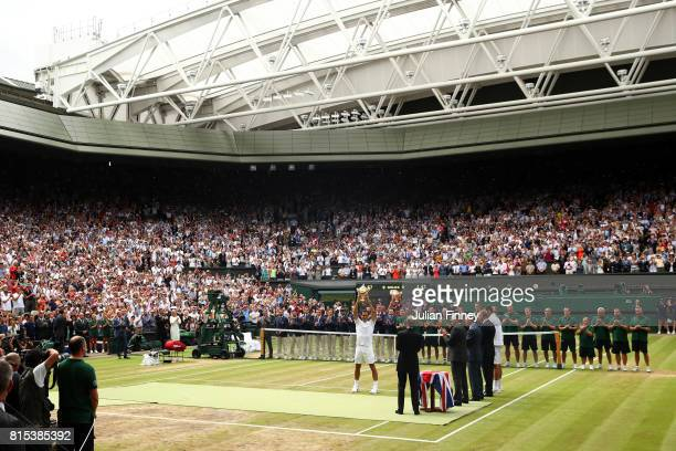 A general view as Roger Federer of Switzerland celebrates victory with the trophy as he after the Gentlemen's Singles final against Marin Cilic of...
