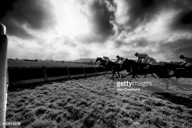 A general view as runners approach a flight of hurdles down the side of the track at Ascot Racecourse on February 18 2017 in Ascot England