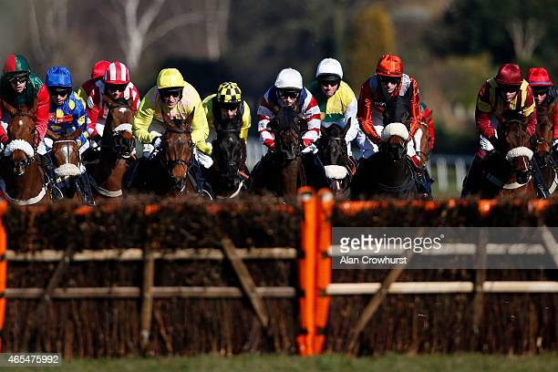 A general view as runners approach a hurdle at Sandown racecourse on March 07 2015 in Esher England