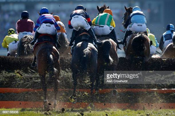 A general view as runners clear a fence at Aintree Racecourse on April 8 2017 in Liverpool England