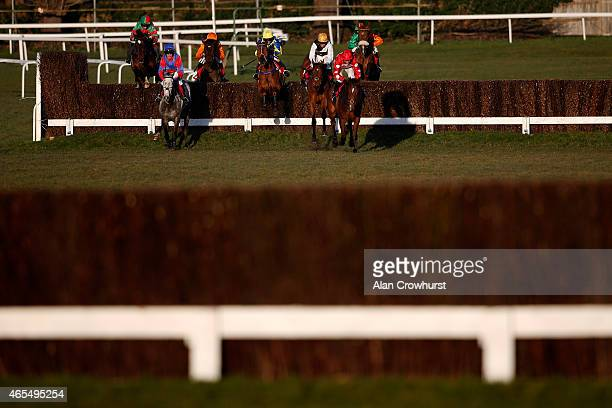 A general view as runners clear a fence at Sandown racecourse on March 07 2015 in Esher England